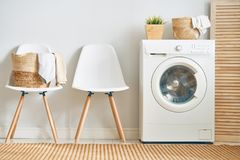Laundry room with a washing machine stock photography