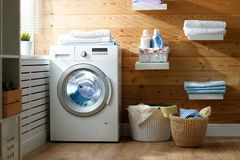 Interior of real laundry room with washing machine at window at. Interior of a real laundry room with a washing machine at the window at home royalty free stock photography