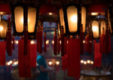 Interior red Chinese lanterns of Man Mo Temple Hong Kong. China, Asia. In the red paper means Wish they could pass the exam Royalty Free Stock Image