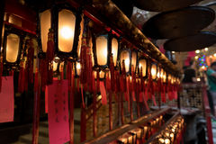 Interior of red Chinese lanterns in Man Mo Temple Hong Kong. China. The chinese language on the red paper means Wish their family happy, joyful, healthy and Stock Photo