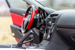 Interior of red sport car Mazda RX-8 in nature. Stock Photography