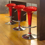 Interior, red stools Stock Photos