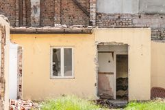 Interior remains of hurricane or earthquake disaster damage on ruined old house in the city with collapsed walls, roof and bricks Royalty Free Stock Photography