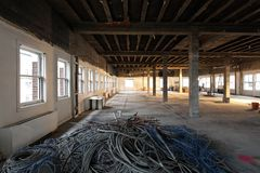 Interior remodel disused cabling for recycle. Piles of disused cabling on the floor from an interior commercial office remodel preparing for an energy efficiency stock photo