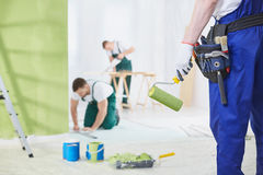 Interior renovation crew. Professional interior renovation crew at work in house Royalty Free Stock Photography