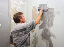 Interior repair work. Worker at work doing indoor house repair with plaster royalty free stock photo
