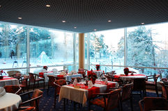 Interior of a restaurant. With winter landscape outside stock images