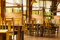 The interior of a restaurant. The interior of the bar, a restaurant with wooden chairs Royalty Free Stock Photo
