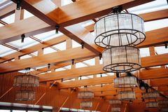 Interior of restaurant with big lamps royalty free stock photos