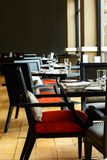 Interior of restaurant with black wooden table and chair Stock Images
