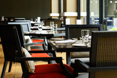 Interior of restaurant with black wooden table and chair Royalty Free Stock Image