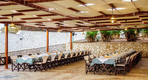 Interior of the restaurant with covered tables Royalty Free Stock Photography
