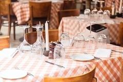 Interior of a restaurant or dining room with candles and glasses. royalty free stock image