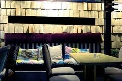 Interior of restaurant. Interior of Italian restaurant, modern style, wall made of opened books Royalty Free Stock Photo
