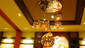 Interior of the restaurant with large chandelier. Royalty Free Stock Photography
