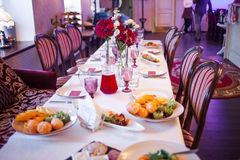 Interior of the restaurant,  large table laid for Royalty Free Stock Photos