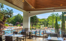 The interior of the restaurant overlooking the pool. Flamingo Grand Hotel. Albena, Bulgaria Royalty Free Stock Image