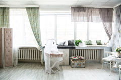 Interior in retro style bright room with a cot and large windows Stock Photo