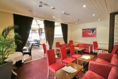 Interior rojo de un restaurante Imágenes de archivo libres de regalías