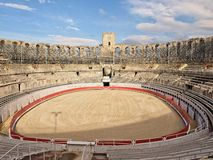 Interior of Roman amphitheatre with arena and bleachers in Arles, France stock photo