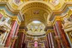 Interior of the roman catholic church St. Stephen`s Basilica. stock photos
