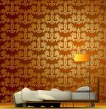 Interior of a room with bed and golden wallpaper. Royalty Free Stock Image