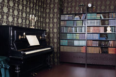 Interior of room with book shelves and piano Royalty Free Stock Photo