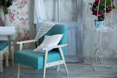 Interior room with chairs, pillows, door and flowers Royalty Free Stock Photography