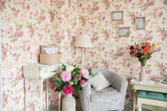 Interior room with chairs, pillowsand flowers Stock Images