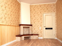Interior of a room with a fireplace Stock Images