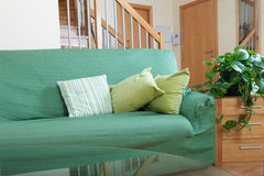 Interior of room with green sofa royalty free stock photos