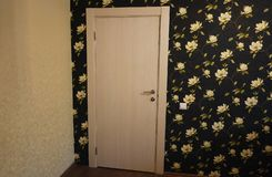 The interior of a room installed with a new interior. door.The installed door harmoniously complements the interior of the room, b stock image