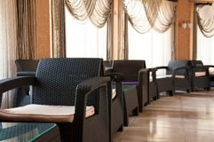 Interior in the room. Many large chairs and tables. royalty free stock photography