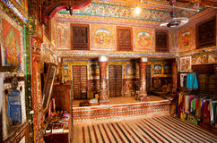 Interior of room with old frescoes in ancient house. MANDAWA, INDIA: Interior of room with old frescoes in ancient Haveli house in Shekhawati. With population of Royalty Free Stock Images