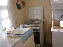 Rural interior of the room in old village of Belarus. Kitchen. Interior of the room in old village of Belarus. Kitchen royalty free stock photography