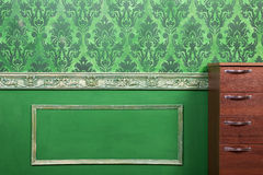 Interior of room painted in green with vintage elements. Retro baroc pattern. Rich vintage interior Stock Images