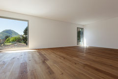 Interior, room with parquet floor and windows Stock Photos