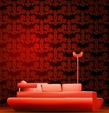 Interior of a room with sofa and red wallpaper. Stock Image