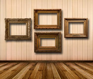 Interior of room with striped wallpaper and gold wooden frames Royalty Free Stock Photo