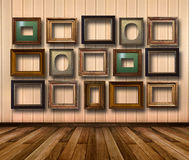 Interior of room with striped wallpaper and gold wooden frames Royalty Free Stock Images