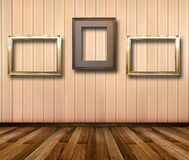 Interior of room with striped wallpaper and gold wooden frames Royalty Free Stock Image