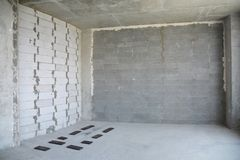 Interior room under construction. Wall without stucco and plaste royalty free stock photography