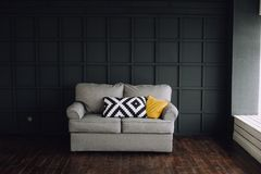 Interior rooms gray sofa black background royalty free stock images