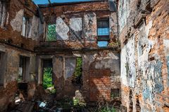 Interior of ruined, abandoned apartment residential building after earthquake or war. Ruins of abandoned ruined house, toned Royalty Free Stock Photography