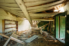 Interior Of Ruined Abandoned Country House With Caved Roof, Evacuation Zone After Chernobyl Disaster Stock Image