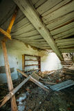 Interior Of Ruined Abandoned Country House With Caved Roof, Evacuation Zone After Chernobyl Disaster Royalty Free Stock Photography