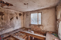 Interior of a ruined house Stock Image
