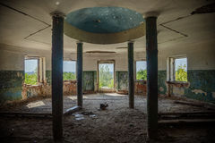 Interior of ruined round hall of an abandoned mansion Earl Voeikov, Penza Region. Interior of ruined round hall with columns at abandoned mansion Earl Voeikov stock photo