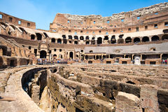 Interior of the Colosseum in Rome. Interior of the ruins of the Colosseum in Rome on a sunny summer day Stock Photos