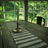 Interior of a rustic house with wooden table Royalty Free Stock Photography